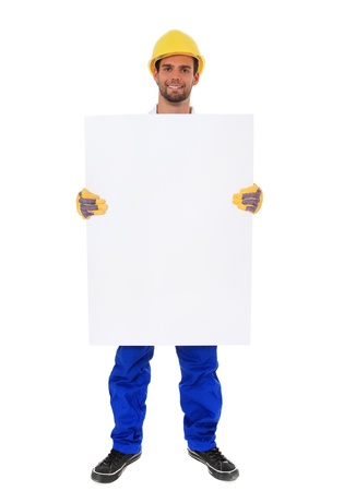 Photo pour Full length shot of a construction worker holding blank sign. All on white background.  - image libre de droit