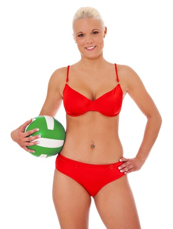Attractive woman in bikini holding a volleyball. Isolated on white background.