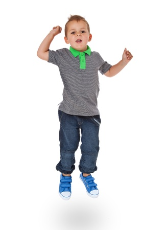 Full length shot of a cute little boy jumping  All isolated on white background