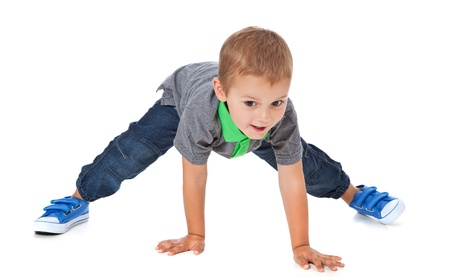 Full length shot of a cute little boy doing sports  All isolated on white background