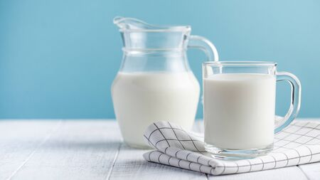 Photo for  Banner of a glass of milk and a jug of milk on a blue background. The concept of farm dairy products, milk day. - Royalty Free Image
