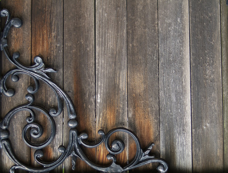 old stained wood with wrought iron design
