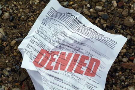 A crumpled up home loan application (stamped with the word