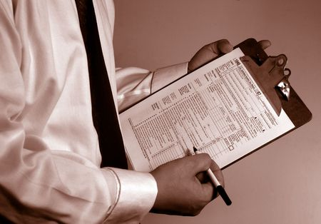 Photo pour man in suit holding tax form - image libre de droit