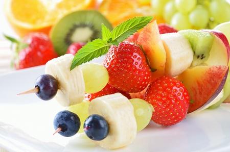 Ripe summer fruit in season on skewers