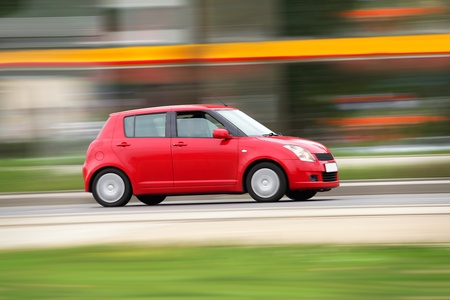 Blur small red economical family compact city car