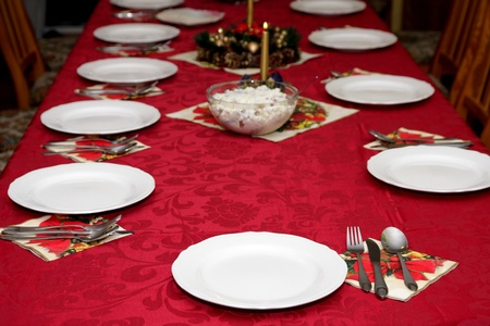Beautiful red table setting for Christmas, holiday background