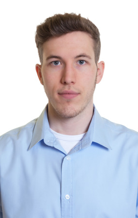 Passport picture of a cool guy in a blue shirt