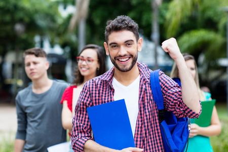 Foto de Successful spanish male student with group of other students - Imagen libre de derechos