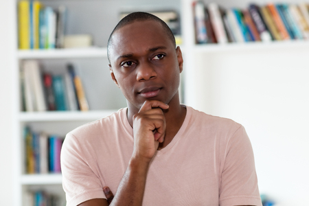 Photo for Thinking african american man with bald head indoors at home - Royalty Free Image