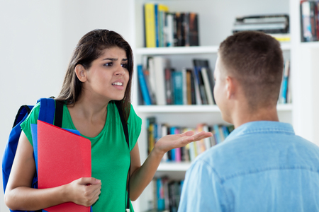 Photo for Italian female student in discussion with male friend - Royalty Free Image