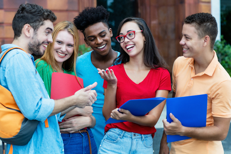 Photo for Group of american and latin and african students talking about homework - Royalty Free Image