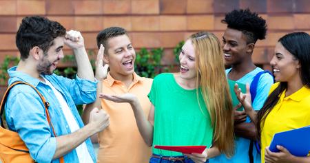 Photo pour Group of students is happy about good grades - image libre de droit