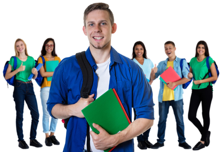 Photo pour German male student with paperwork and group of students - image libre de droit