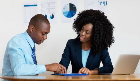 Photo for African american businesswoman talking with client about contract - Royalty Free Image