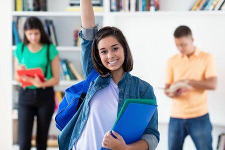 Photo pour Successful spanish female student with group of students - image libre de droit