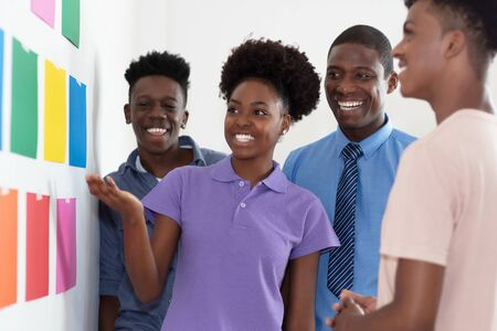 Photo for Afro american male and female students with teacher at creative workshop - Royalty Free Image