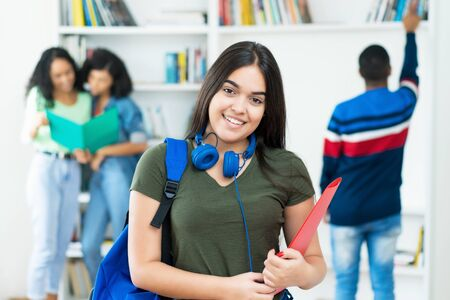 Photo for Laughing spanish female student with group of students at university - Royalty Free Image
