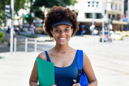 Photo pour Laughing african american female student outdoor in city - image libre de droit