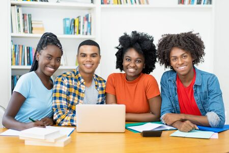 Photo for Group photo of african american and latin students at computer - Royalty Free Image