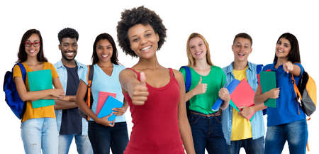 Photo pour Pretty african american young adult woman with large group of international students - image libre de droit