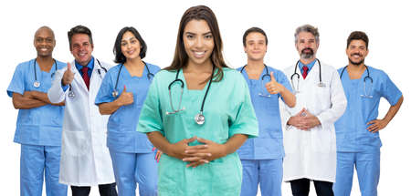 Photo pour Beautiful latin american female nurse with doctor and medical team - image libre de droit