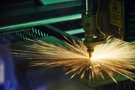 Photo for Laser cutting. Metal machining with sparks - Royalty Free Image