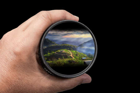 Photo pour photography view camera photographer lens lense through video photo digital glass hand blurred focus people sun sunset sunrise cloud sky water lake concept - stock image hand holding a lens camera travel photography Asia in nature - image libre de droit