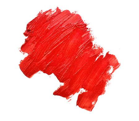 smudged lipsticks on white background