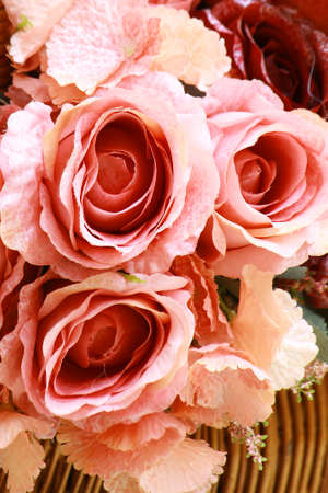 Bouquet of artificial rose flowers for background or greeting card