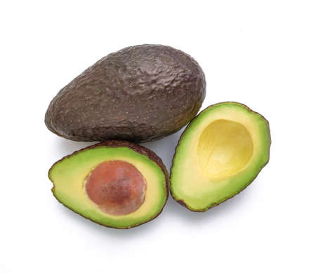Photo for Hass avocado pear (Persea americana) halved and whole on white background with top view - Royalty Free Image