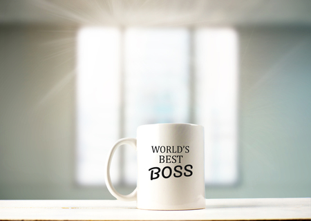 Foto de World's best boss text on coffee mug in coffeee - Imagen libre de derechos
