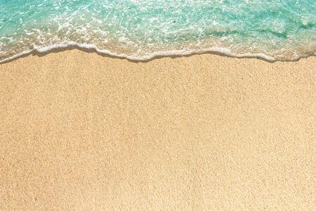 Photo pour Soft waves with foam of blue ocean on the sandy beach - image libre de droit