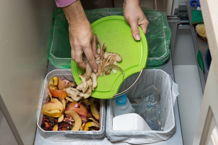 Photo pour Household waste sorting and recycling kitchen bins in the drawer. Collecting food leftovers for composting. Environmentally responsible behavior, ecology concept. - image libre de droit