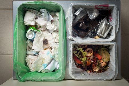 Household waste sorting and recycling kitchen bins in the drawer. Responsible behavior, ecology concept.