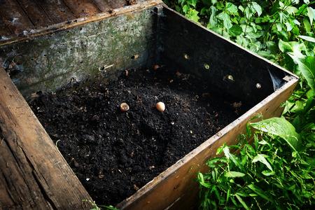 Photo pour Ready made compost pile in wooden crate - image libre de droit