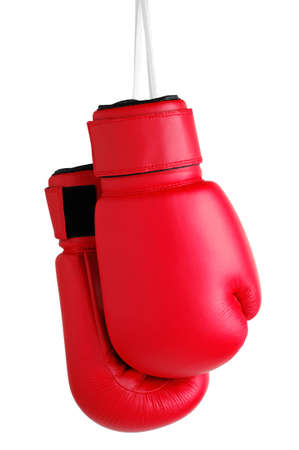 Photo pour Boxing Gloves hanging by their laces against a white background - image libre de droit
