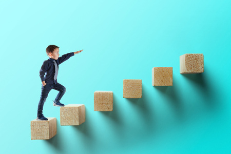 Foto de growth business concept. young businessman climbing the career ladder - Imagen libre de derechos