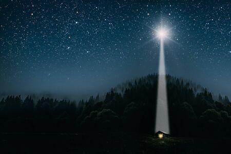 Photo pour The moon shines over the manger of christmas of Jesus Christ. - image libre de droit
