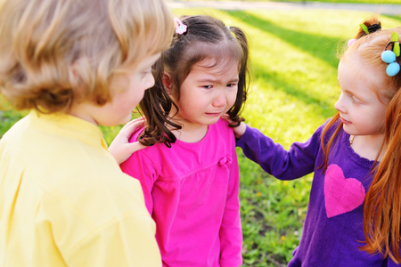 Photo for children feel sorry for a weeping little girl. Childhood, friends, crying, friendship, pity, feelings compassion - Royalty Free Image