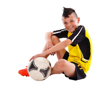 Teenage boy with soccer ball, studio shot
