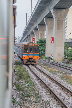 Train   is a group of vehicles that travel along the rails to the transport of goods or passengers from one place to another. Most tracks usually consist of two parallel rails.
