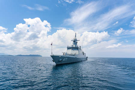PHANG NGA, THAILAND - APRIL 3, 2019 : HTMS Bhumibol Adulyadej (FFG471) stealth frigate of Royal Thai Navy anchors in the sea