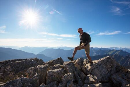 Photo for Backpacker in hike in the autumn mountains - Royalty Free Image