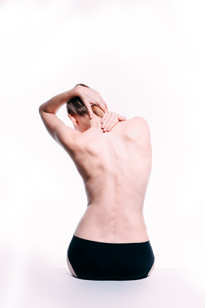 Photo for Beautiful athletic blond caucasian woman's body. Nude woman back. Naked woman in towel is sitting. Studio shot Back view, isolated on white background. - Royalty Free Image