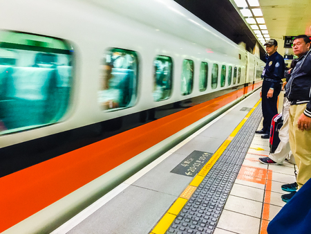 Taoyuan, Taiwan - November 20, 2015: View at the platform of Taiwan High Speed Rail (HSR) Taoyuan Station. The high speed railway has become the most important transportation that runs approximately 345 km along the west coast of Taiwan.