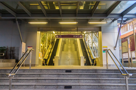 Bangkok, Thailand - January 28, 2017: Stairway and elevators at Tao Poon MRT purple line station with no passenger