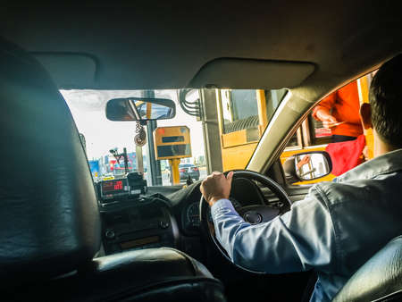 Photo for Taxi driver stop the car on express way, tollway or motorway gate booth for paying toll fee. - Royalty Free Image
