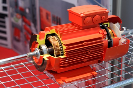 The red electric motor is presented in a cut