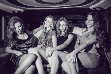Foto de Sexy girls. Party in the car. Black and white - Imagen libre de derechos